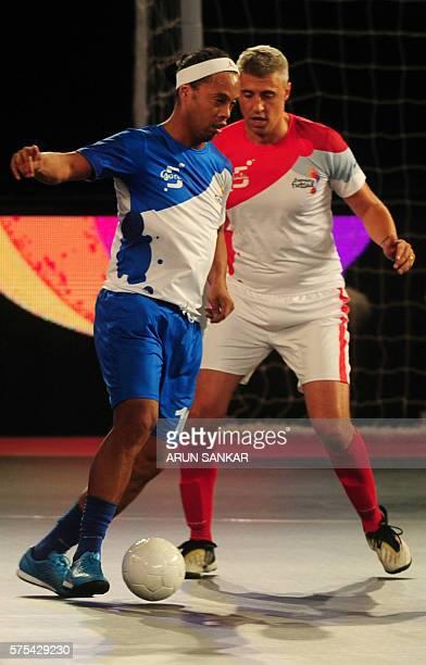 Ronaldhino from the Goa 5's plays against the Kolkata 5's Hernan Crespo during their Premier Futsal Football League match in Chennai on July 15 2016...