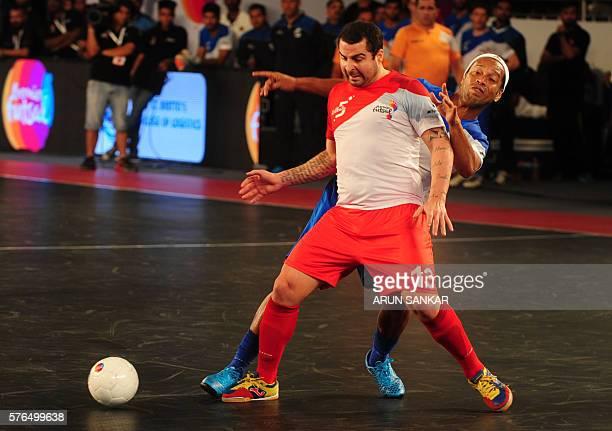 Ronaldhino from the Goa 5's plays against the Kolkata 5's Vander Carioca during their Premier Futsal Football League match in Chennai on July 15 2016...
