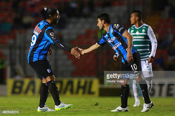 Ronaldinho and Antonio Naelson of Queretaro shake their hands during a match between Queretaro and Santos Laguna as part of 4th round Clausura 2015...