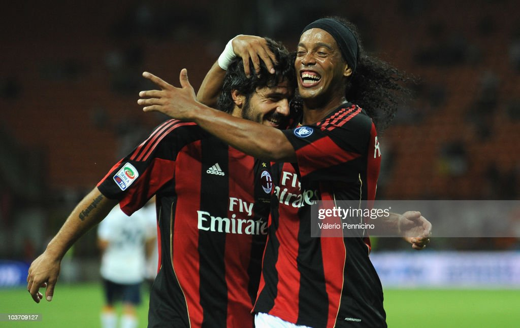 Ronaldinho (R) and Gennaro Ivan Gattuso of AC Milan celebrate victory during the Serie A match between AC Milan and US Lecce at Stadio Giuseppe Meazza on August 29, 2010 in Milan, Italy.