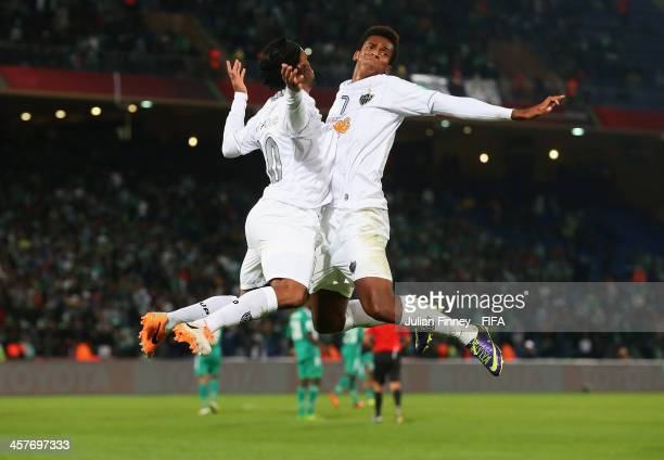 Ronaldinho and Jo of Atletico Mineiro celebrate Ronaldinho's goal to make it 11 during the FIFA Club World Cup Semi Final match between Raja...