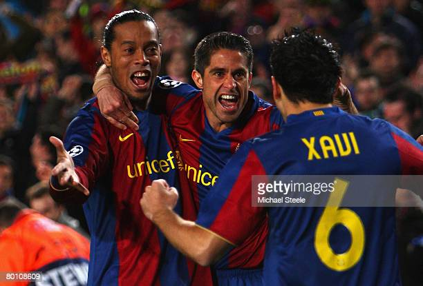 Ronaldinho and Sylvinho of Barcelona celebrate the goal scored by Xavi during the UEFA Champions League 2nd leg of the First knockout round match...