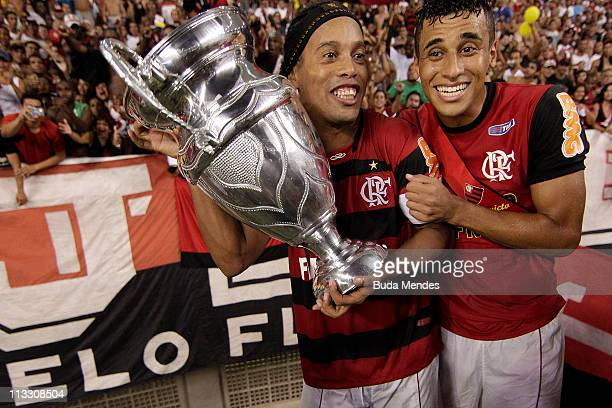 Ronaldinho and Welinton of Flamengo celebrate after winning the 2011 Rio State Championship at Engenhao stadium on May 1 2011 in Rio de Janeiro...