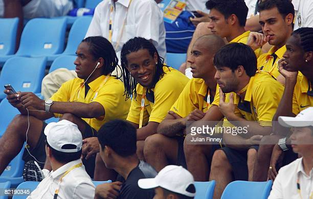 Ronaldinho Anderson and Diego sit with Brazilian team mates and watch the women's preliminary group F match between Germany and Brazil at Shenyang...