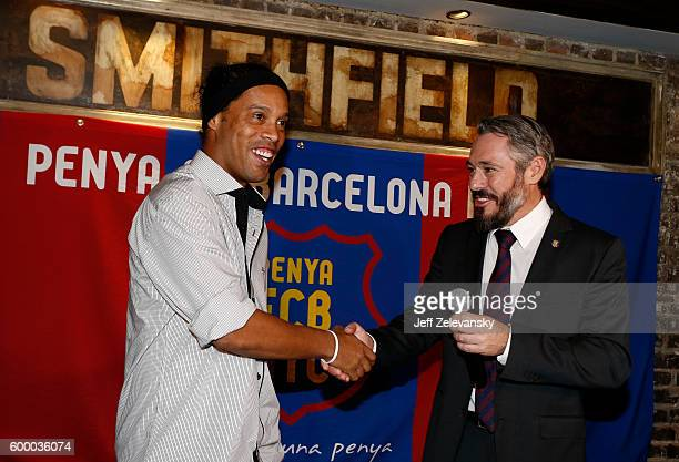 Ronaldinho is greeted by Jordi GetmanEraso President of Penya FC Barcelona New York City at Smithfield Hall on September 7 2016 in New York City