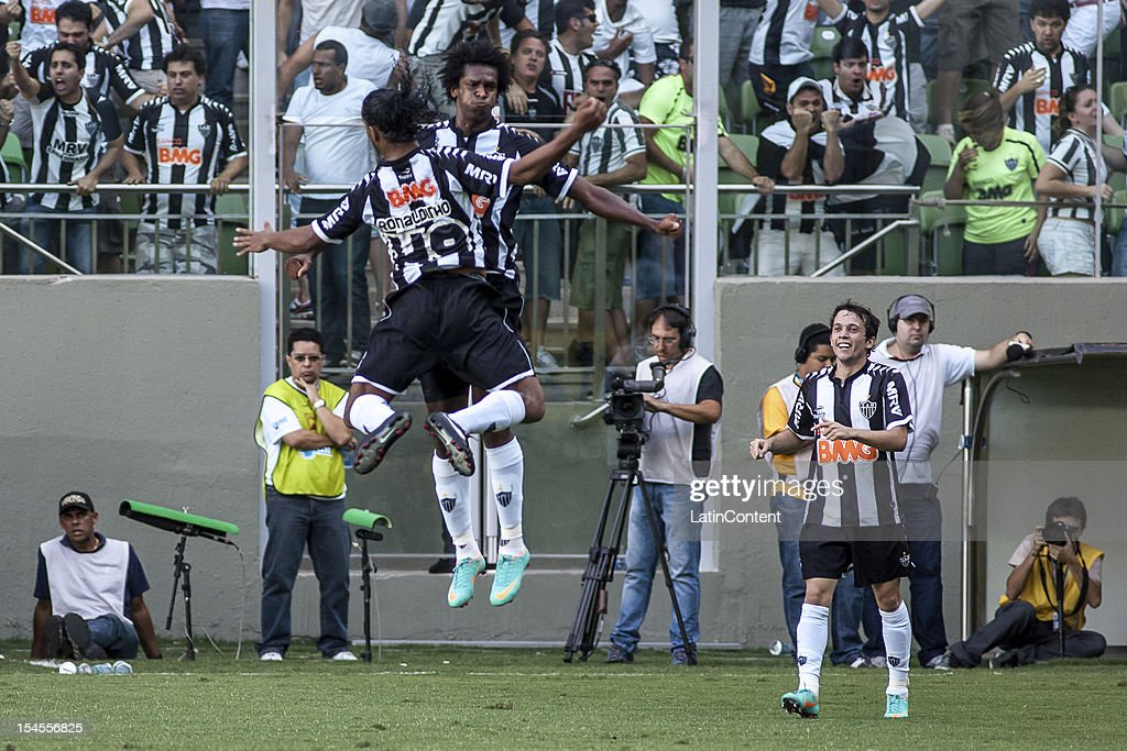 Ronaldinho Jo and Bernard of Atlético MG celebrate a goal during a match between Atletico MG and Fluminense as part of Campeonato Brasileiro 2012 at...