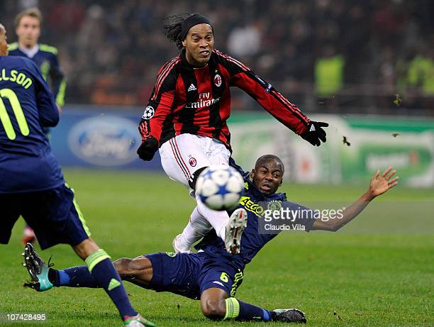 Ronaldinho of AC Milan and Eyong Enoh of AFC Ajax compete for the ball during the UEFA Champions League Group G match between AC Milan and AFC Ajax...