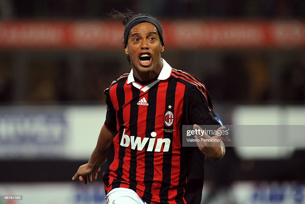 <a gi-track='captionPersonalityLinkClicked' href=/galleries/search?phrase=Ronaldinho&family=editorial&specificpeople=202667 ng-click='$event.stopPropagation()'>Ronaldinho</a> of AC Milan celebrates his goal during the Serie A match between AC Milan and ACF Fiorentina at Stadio Giuseppe Meazza on May 1, 2010 in Milan, Italy.