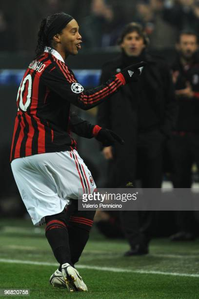 Ronaldinho of AC Milan celebrates the opening goal during the UEFA Champions League round of 16 first leg match between AC Milan and Manchester...