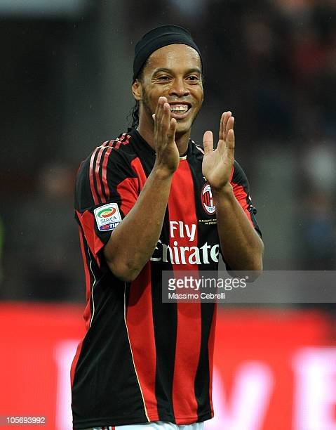 Ronaldinho of AC Milan cheers his team mate Zlatan Ibrahimovic on during the Serie A match between AC Milan and AC Chievo Verona at Stadio Giuseppe...