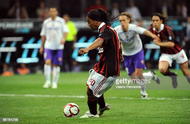 Ronaldinho of AC Milan scores his goal from the penalty spot during the Serie A match between AC Milan and ACF Fiorentina at Stadio Giuseppe Meazza...