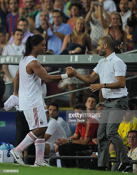 Ronaldinho of AC Milan shakes hands with his former Manager Jesep Guardiola of Barcelona during the Joan Gamper Trophy match between Barcelona and AC...