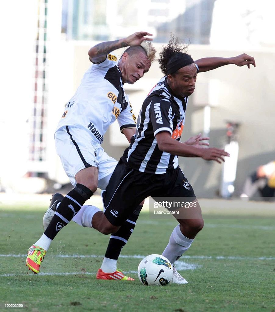 <a gi-track='captionPersonalityLinkClicked' href=/galleries/search?phrase=Ronaldinho&family=editorial&specificpeople=202667 ng-click='$event.stopPropagation()'>Ronaldinho</a> of Atletico MG struggles for the ball during a match between Botafogo and Atletico MG as part ot the Brazilian Championship at Independence Stadium on August 19, 2012 in Belo Horizonte, Brazil.