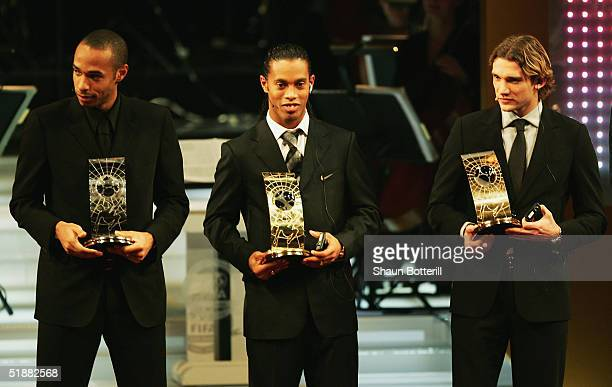 Ronaldinho of Barcelona and Brazil Thierry Henry of Arsenal and France and Andriy Shevchenko of AC Milan and Ukraine during the FIFA Centenial World...