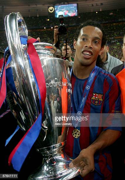 Ronaldinho of Barcelona carries the trophy in celebration after his team wins the UEFA Champions League Final between Arsenal and Barcelona at the...