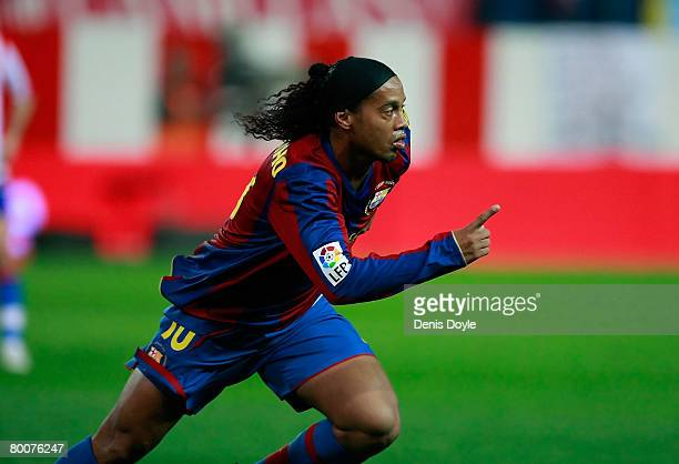 Ronaldinho of Barcelona celebrates after scoring his team's first goal during the La Liga match between Atletico Madrid and Barcelona at the Vicente...