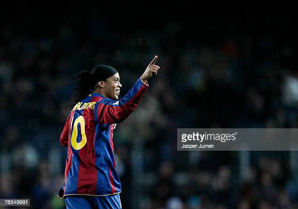 Ronaldinho of Barcelona celebrates his opening goal during the La Liga match between Barcelona and Deportivo La Coruna at the Camp Nou Stadium on...