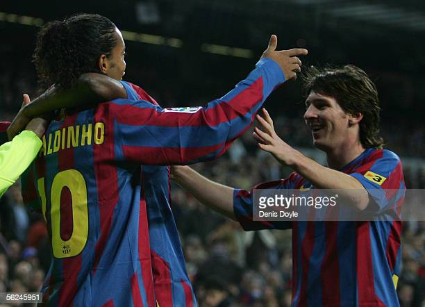 Ronaldinho of Barcelona celebrates with Lionel Messi after scoring a goal during the Primera Liga match between Real Madrid and FC Barcelona at the...