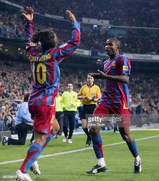 Ronaldinho of Barcelona celebrates with Samuel Eto'o after scoring a goal during a Primera Liga match between Real Madrid and FC Barcelona at the...