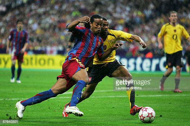 Ronaldinho of Barcelona challenges Ashley Cole of Arsenal during the UEFA Champions League Final between Arsenal and Barcelona at the Stade de France...