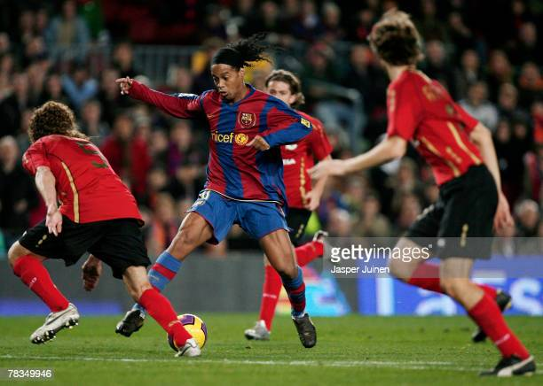 Ronaldinho of Barcelona controls the ball surrounded by Deportivo La Coruna players during the La Liga match between Barcelona and Deportivo La...