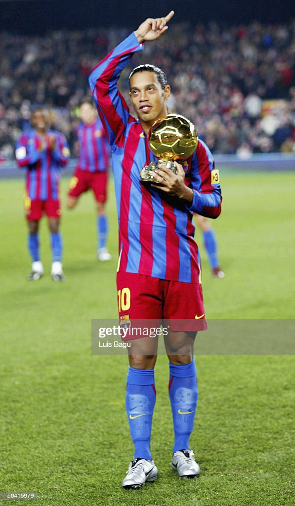 Ronaldinho of Barcelona is applauded by his team-mates as he holds the Ballon D'Or award for European Footballer of the Year on the pitch before the Primera Liga match between Barcelona and Sevilla on December 11, 2005 at the Camp Nou stadium in Barcelona, Spain.