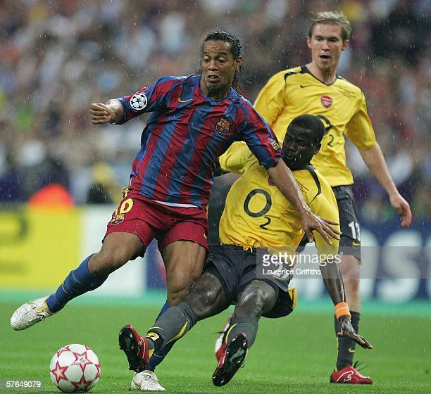 Ronaldinho of Barcelona is tackled by Emmanuel Eboue of Arsenal during the UEFA Champions League Final between Arsenal and Barcelona at the Stade de...