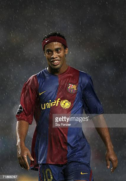 Ronaldinho of Barcelona raises a smile despite the wet weather during the UEFA Champions League Group A match between Barcelona and Levski Sofia at...