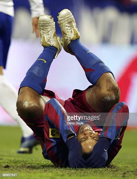 Ronaldinho of Barcelona reacts after being tackled by Leonardo Ponzio of Real Zaragoza during a Primera Liga match between Real Zaragoza and...
