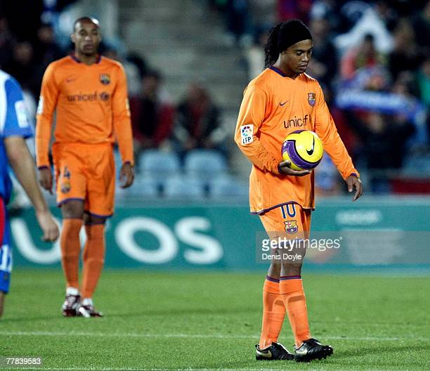 Ronaldinho of Barcelona reacts after Getafe score their first goal during the La Liga match between Getafe and Barcelona at the Coleseum Alfonso...