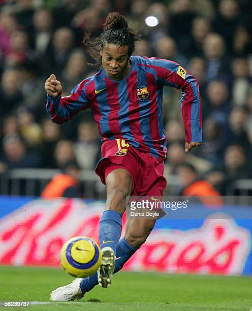 Ronaldinho of Barcelona scores a goal against Real Madrid during a Primera Liga match between Real Madrid and FC Barcelona at the Bernabeu on...