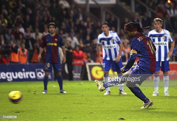 Ronaldinho of Barcelona scores from the penalty spot during the Primera Liga match between Deportivo La Coruna and Barcelona at the Riazor stadium...