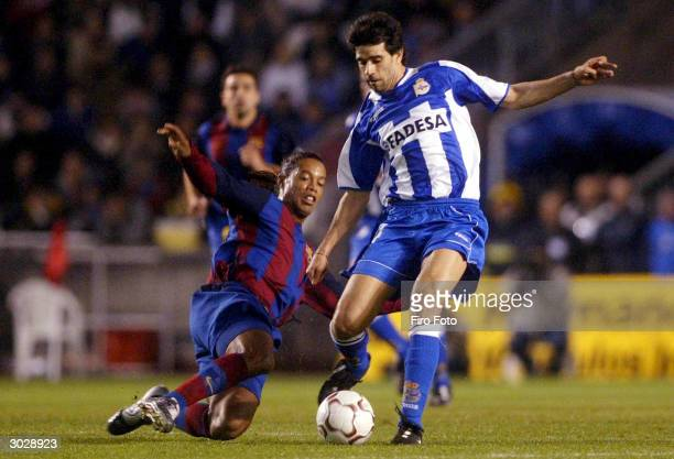 Ronaldinho of Barcelona tackles Juan Carlos Valeron of Deportivo during the Spanish Primera Liga match between Deportivo de La Corua and Barcelona at...