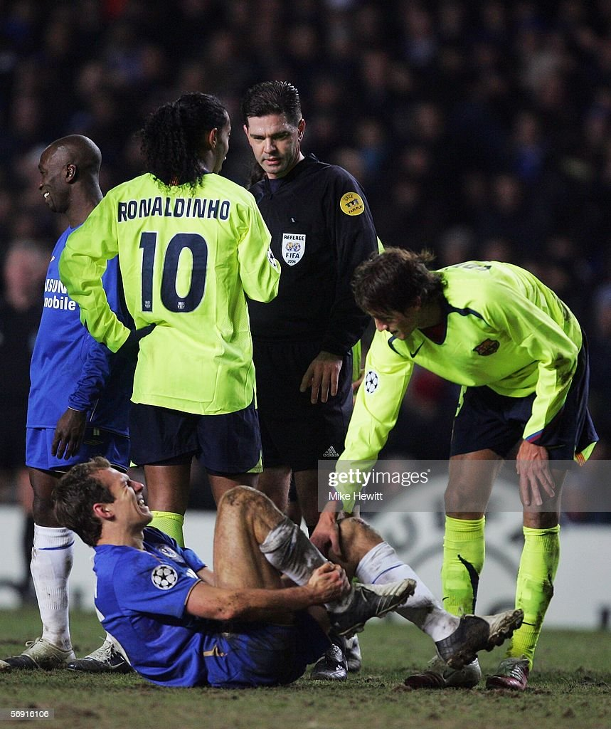 Ronaldinho of Barcelona talks to referee Terje Hauge as Arjen Robben of Chelsea waits for treatment during the UEFA Champions League Round of 16, First Leg match between Chelsea and Barcelona at Stamford Bridge on February 22, 2006 in London, England.