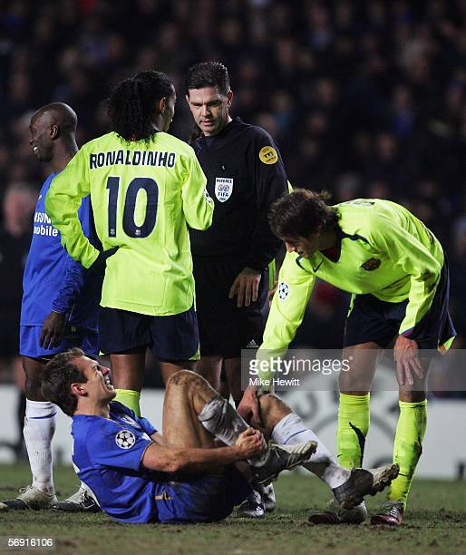 Ronaldinho of Barcelona talks to referee Terje Hauge as Arjen Robben of Chelsea waits for treatment during the UEFA Champions League Round of 16...