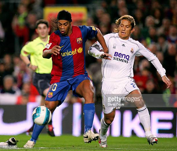Ronaldinho of Barcelona vies for the ball with Michel Salgado of Real Madrid during the Primera Liga match between Barcelona and Real Madrid at the...