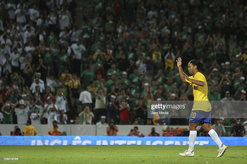 <a gi-track='captionPersonalityLinkClicked' href=/galleries/search?phrase=Ronaldinho&family=editorial&specificpeople=202667 ng-click='$event.stopPropagation()'>Ronaldinho</a> of Brasil celebrates a scored goal during a match against Mexico as part a friendly match between Mexico National Team and Brasil National Team at the Corona stadium on October 11, 2011 in Torreon, Mexico.