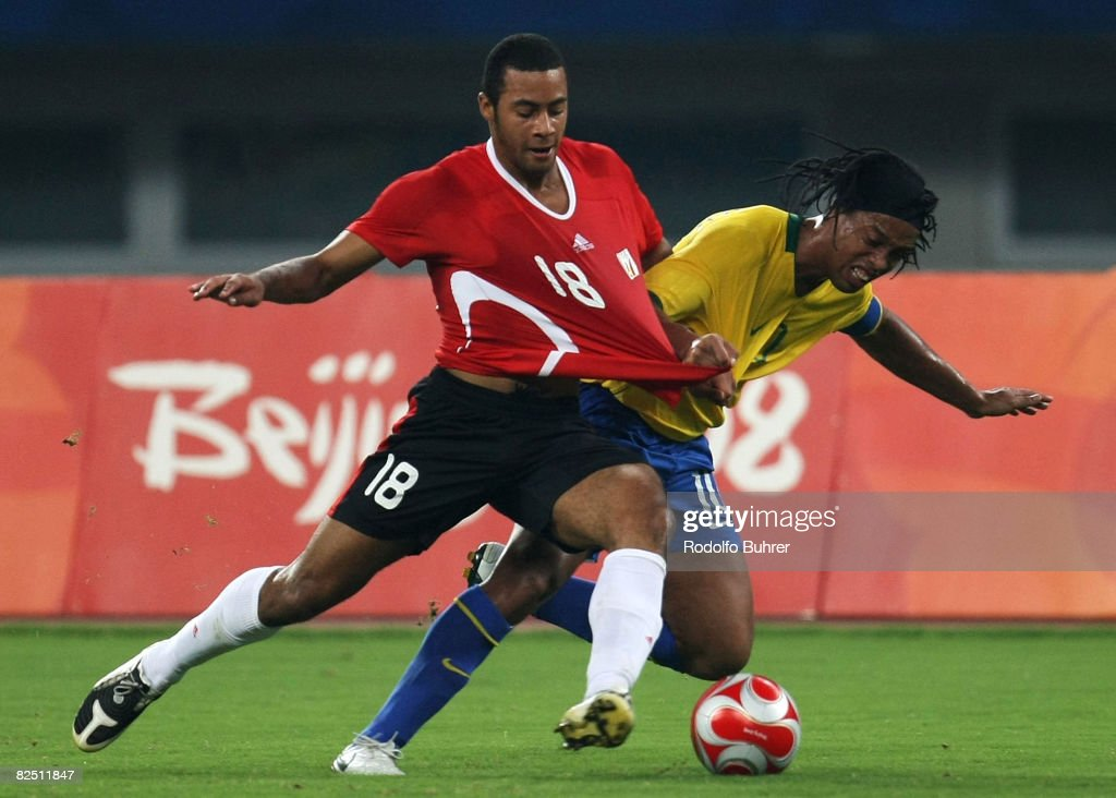 Ronaldinho of Brazil and Moussa Dembele (L) of Belgium compete for the ball during the Bronze Medal Match between Belgium and Brazil at Shanghai Stadium on Day 14 of the Beijing 2008 Olympic Games on August 22, 2008 in Shanghai, China.