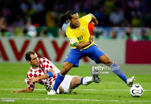 Ronaldinho of Brazil attempts to elude the tackle of Igor Tudor of Croatia during the FIFA World Cup Germany 2006 Group F match between Brazil and...
