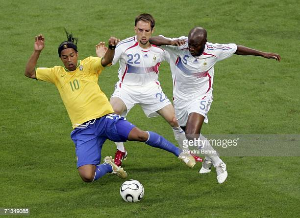 Ronaldinho of Brazil battles for the ball with Frank Ribery and William Gallas of France during the FIFA World Cup Germany 2006 Quarterfinal match...