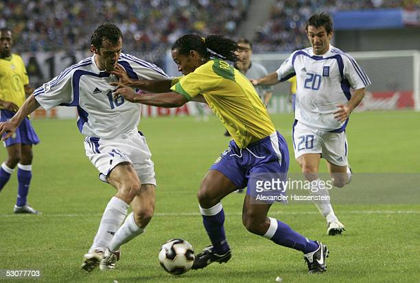 Ronaldinho of Brazil challenges for the ball with Ioannis Goumas and Georgios Karagounis of Greece during the FIFA Confederations Cup 2005 Match...