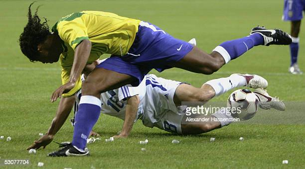 Ronaldinho of Brazil challenges for the ball with Ioannis Goumas of Greece during the FIFA Confederations Cup 2005 Match between Brazil and Greece on...