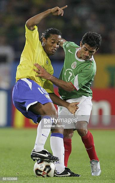 Ronaldinho of Brazil challenges with Zinha of Mexico during the FIFA Confederations Cup 2005 match between Mexico and Brazil on June 19 2005 in...