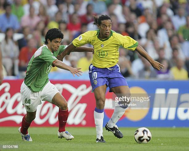 Ronaldinho of Brazil is challenged by Gonzalo Pineda of Mexico during The FIFA Confederations Cup Match between Mexico and Brazil at The AWD Arena on...