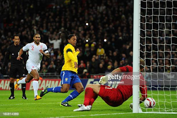 Ronaldinho of Brazil sees his penalty saved by Joe Hart of England during the International friendly between England and Brazil at Wembley Stadium on...
