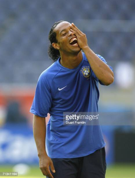 Ronaldinho of Brazil shares a joke during the Brazil National Football Team training session for the FIFA World Cup Germany 2006 at the FIFA World...