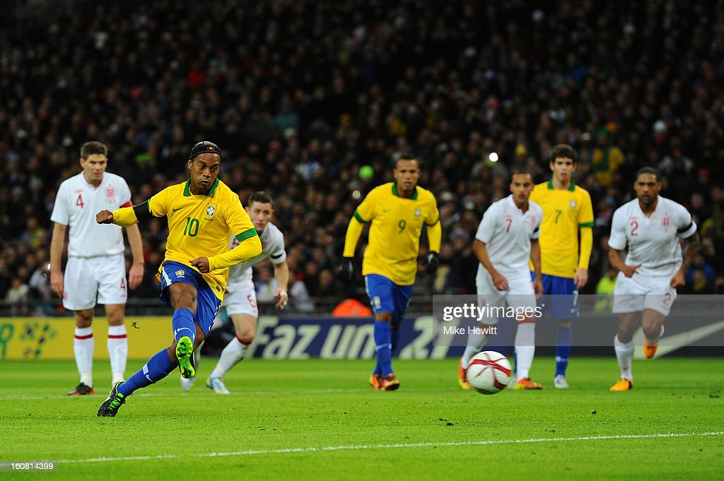 <a gi-track='captionPersonalityLinkClicked' href=/galleries/search?phrase=Ronaldinho&family=editorial&specificpeople=202667 ng-click='$event.stopPropagation()'>Ronaldinho</a> of Brazil shoots and sees his penalty saved by Joe Hart of England (not pictured) during the International friendly between England and Brazil at Wembley Stadium on February 6, 2013 in London, England.
