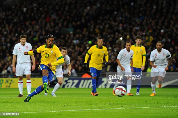 Ronaldinho of Brazil shoots and sees his penalty saved by Joe Hart of England during the International friendly between England and Brazil at Wembley...