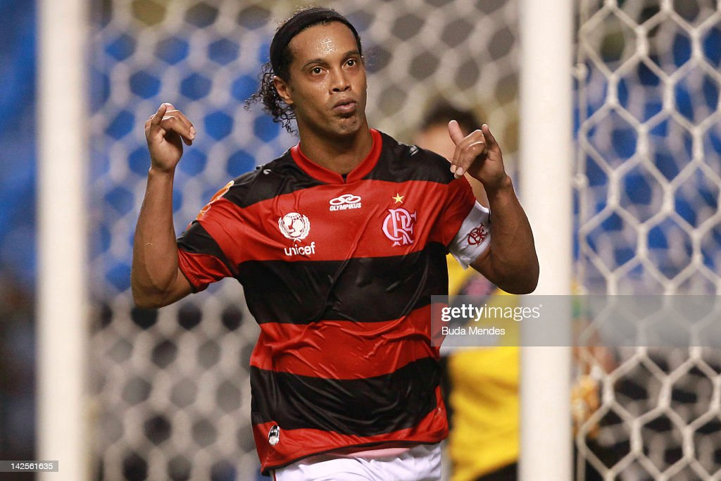 <a gi-track='captionPersonalityLinkClicked' href=/galleries/search?phrase=Ronaldinho&family=editorial&specificpeople=202667 ng-click='$event.stopPropagation()'>Ronaldinho</a> of Flamengo celebrates a scored goal aganist Vasco during a match between Flamengo and Vasco as part of Rio State Championship 2012 at Engenhao stadium on April 07, 2012 in Rio de Janeiro, Brazil.