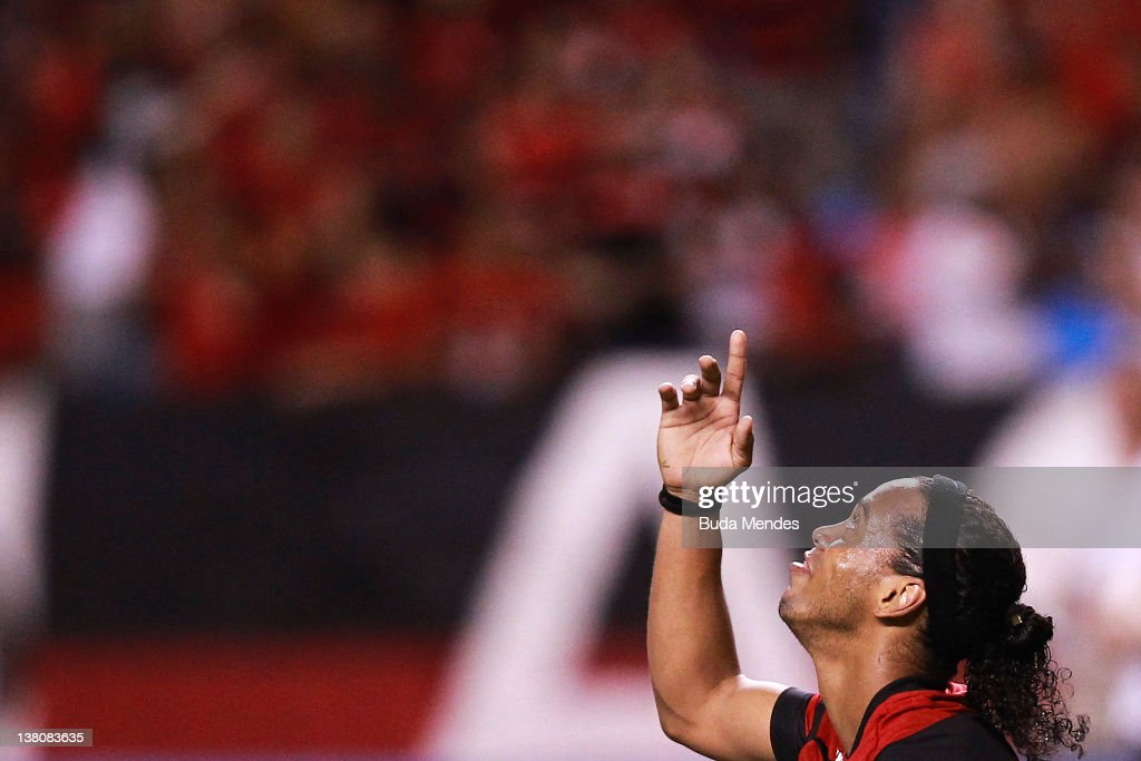 <a gi-track='captionPersonalityLinkClicked' href=/galleries/search?phrase=Ronaldinho&family=editorial&specificpeople=202667 ng-click='$event.stopPropagation()'>Ronaldinho</a> of Flamengo reacts during a match between Flamengo v Real Potosi as part of Santander Libertadores Cup 2012 at Engenhao stadium on February 01, 2012 in Rio de Janeiro, Brazil.